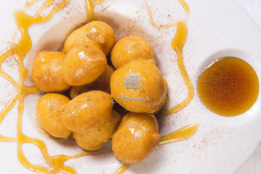 Loukoumades with potatoes, ouzo and honey